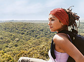 Woman Sitting on a Mountain Top Looking at View
