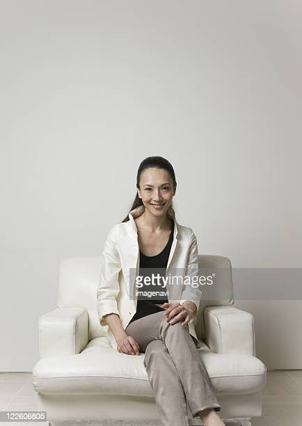 Woman sitting on a sofa