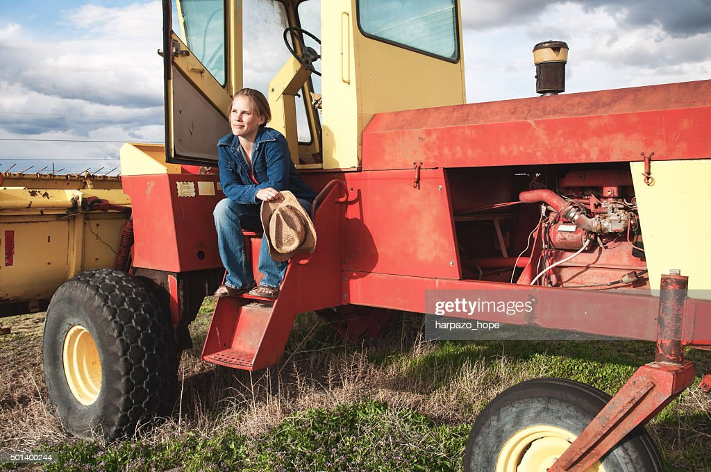 Woman Sitting on a Swather