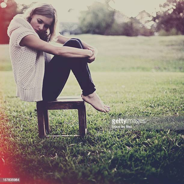 Woman sitting on chair in park