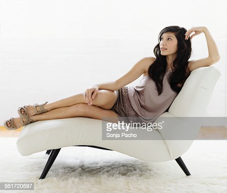 Woman Sitting on Chaise Lounge