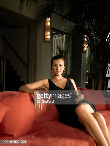 Woman sitting on couch, portrait : Stock Photo
