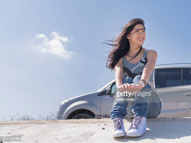 Woman sitting on dike with sweet smile
