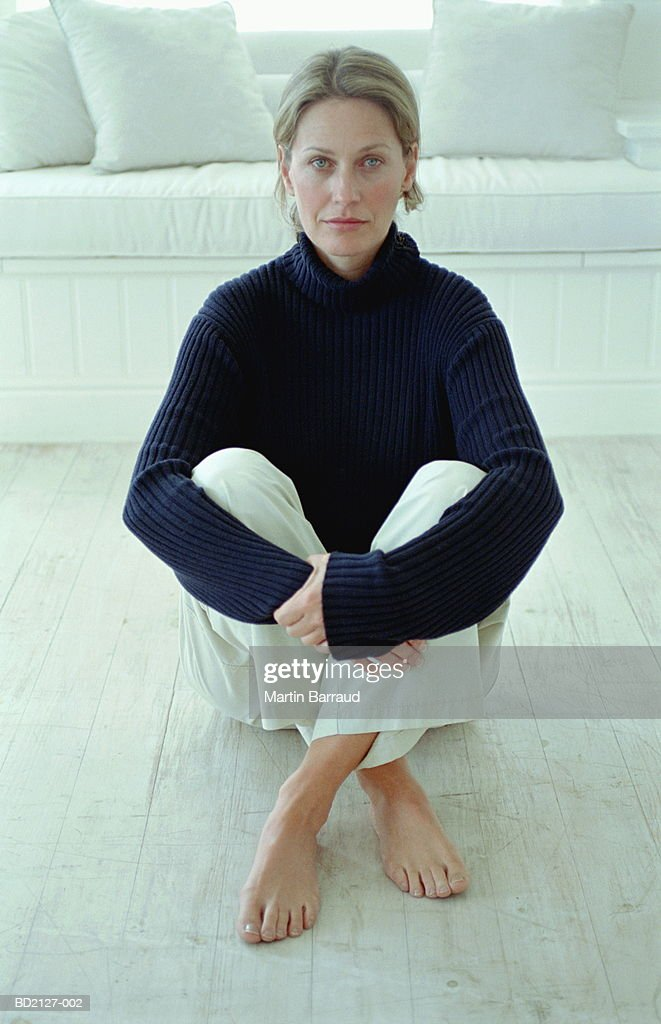 Woman sitting on floor, close-up, portrait : Stock Photo