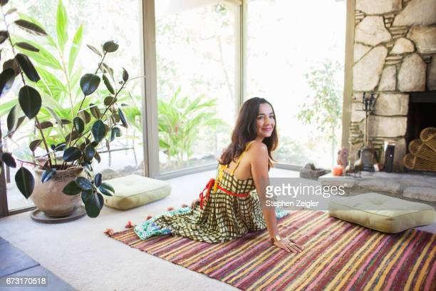 Woman sitting on floor of living room