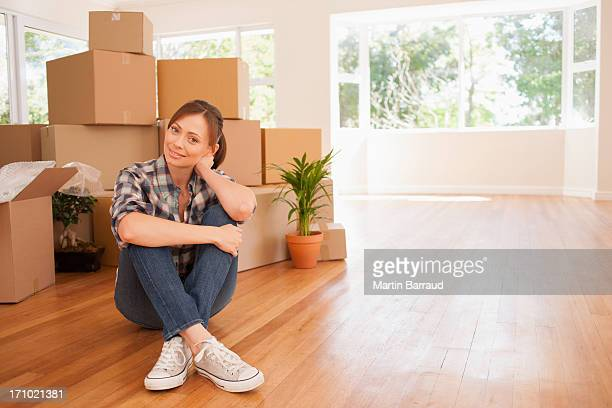 Woman sitting on floor of new house