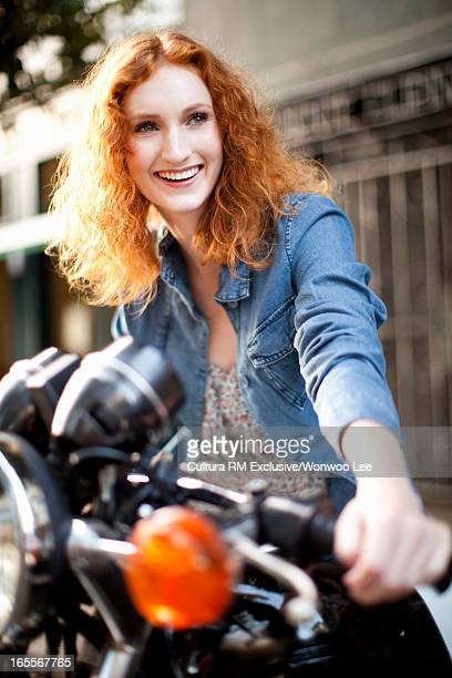 Woman sitting on motorcycle