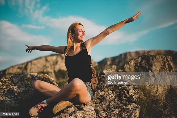 Woman sitting on mountain