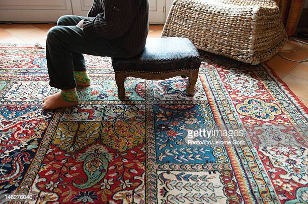 Ottoman sofas stock photos and pictures getty images for Ottoman to sit on