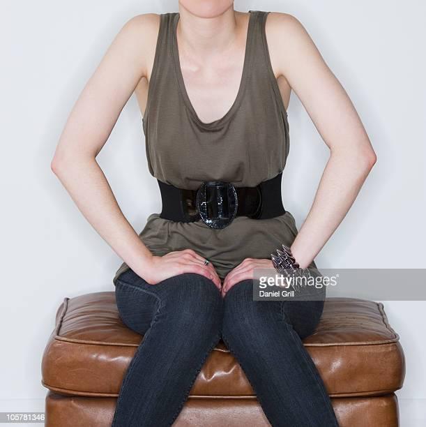 Woman sitting on ottoman