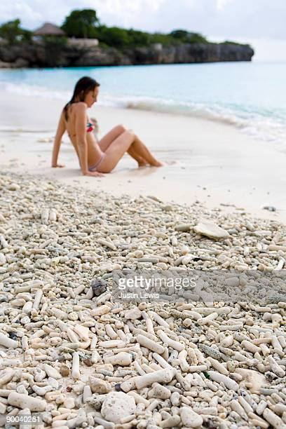Woman sitting on Playa Knip Beach in Curacao.