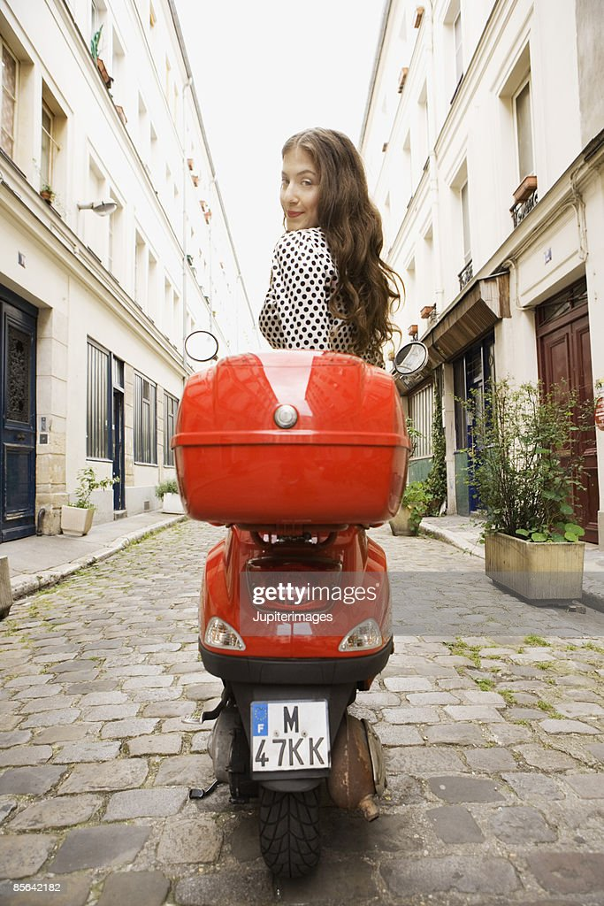 Woman sitting on scooter