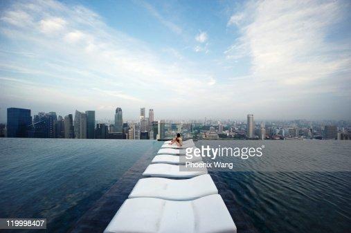 Woman sitting on sky park