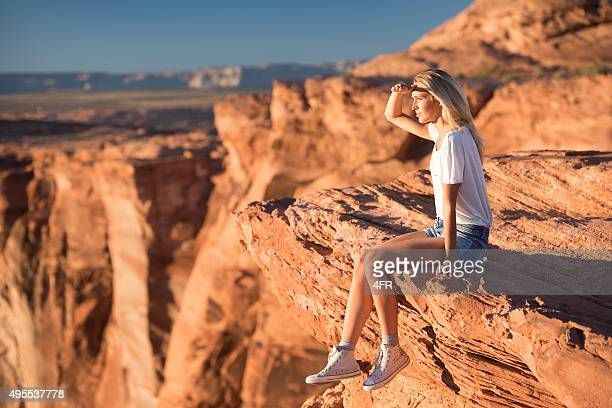 Woman Sitting on the Edge enjoying the view, Horseshoe Bend
