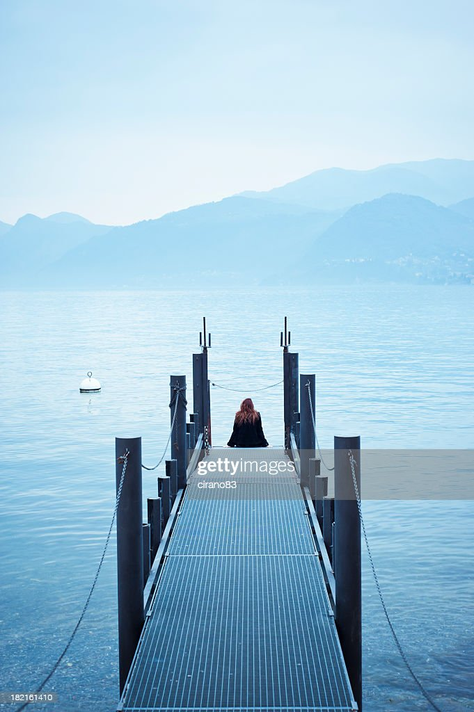 Woman Sitting On The Pier In Lake Como : Stock Photo