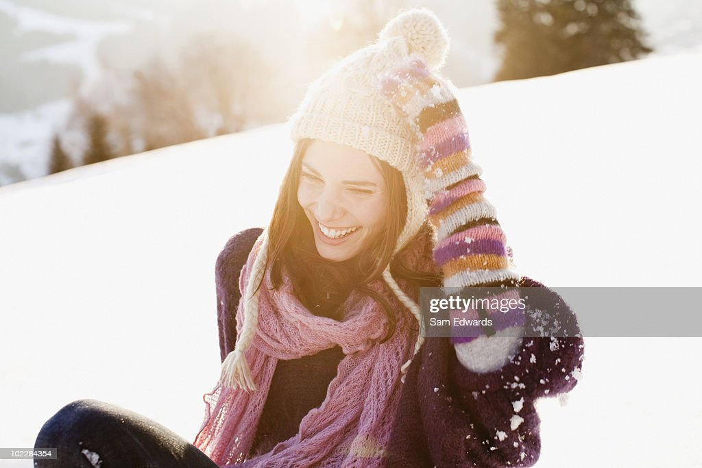 Woman sitting outdoors in snow