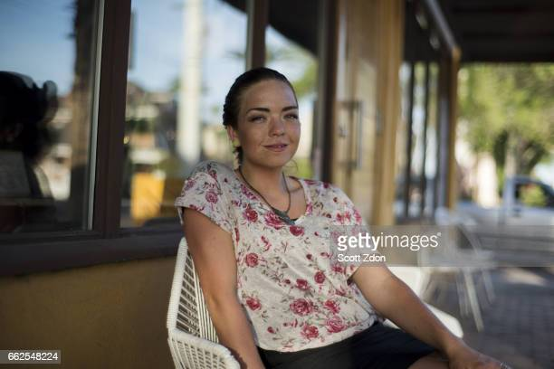 Woman sitting outside cafe