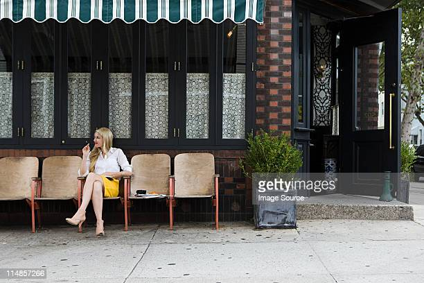 Woman sitting outside coffee shop