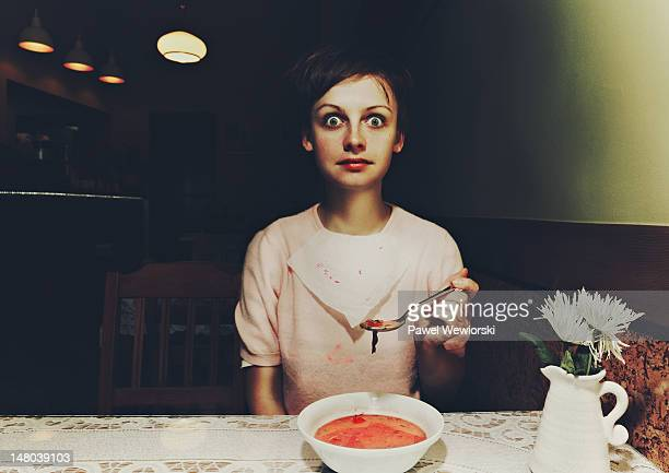 Woman sitting over beetroot soup