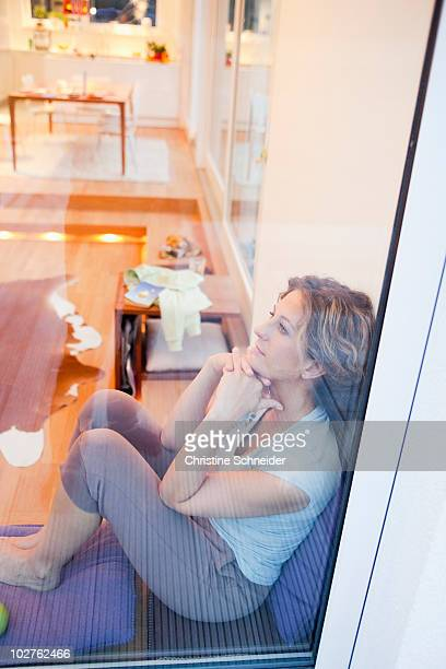 Woman sitting relaxed on a window