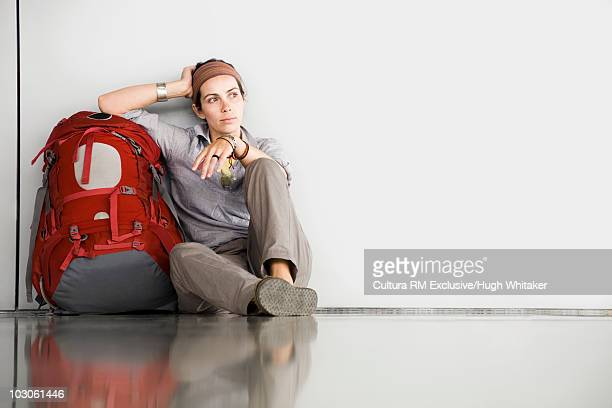 Woman sitting with backpack