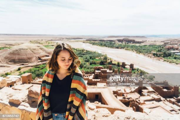 Woman sitting with view on Ait Ben Haddou Casbah