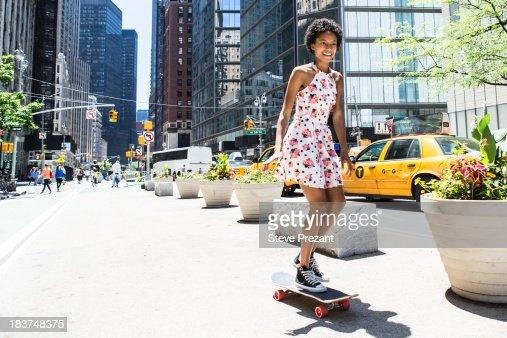 Woman skateboarding : Stock Photo