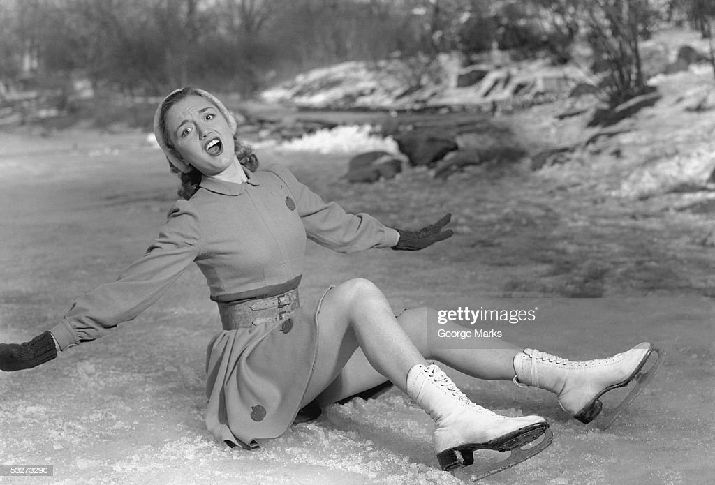 Woman skater fallen on ice : Stock Photo
