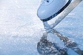 'Woman skates braking ice, frazil flying around'