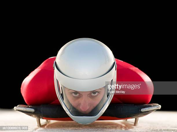 Woman skeleton athlete in crash helmet on skeleton, portrait, close-up