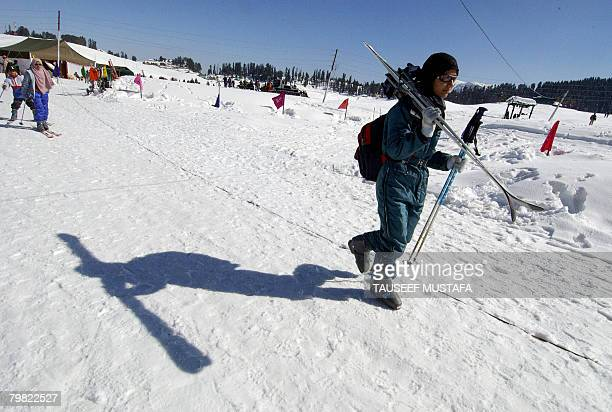 A woman skier proceeds towards a slope at the ski resort of Gulmarg on February 18 2008 The ski resort was abuzz with activity as India's national...