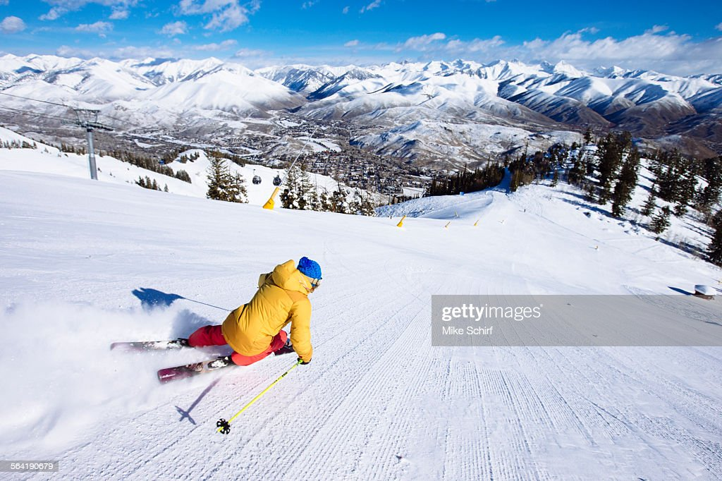 A woman skiing fresh groomers.