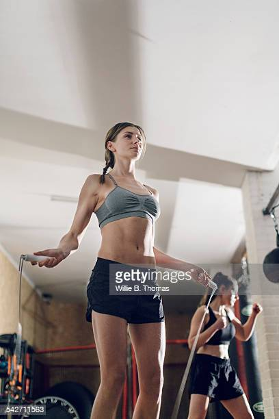 Woman skipping rope in gym