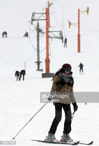 A woman skis at the Oukaimeden ski resort in the Atlas Mountains 30 kilometres from the popular tourist resort of Marrakesh on February 17 2015 On a...