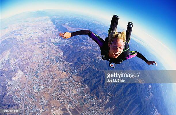 Woman skydiving, aerial view, California, USA (wide angle)