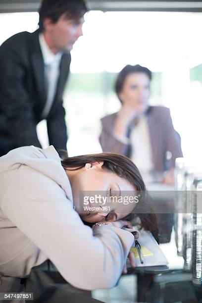 Woman sleeping during a business meeting