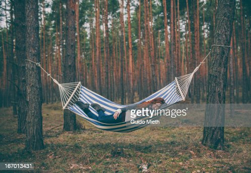 Woman sleeping in a hammock in the wood. : Stock Photo