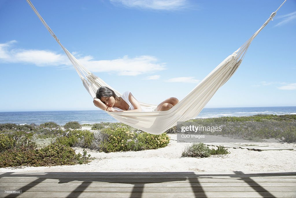 Woman sleeping in a hammock