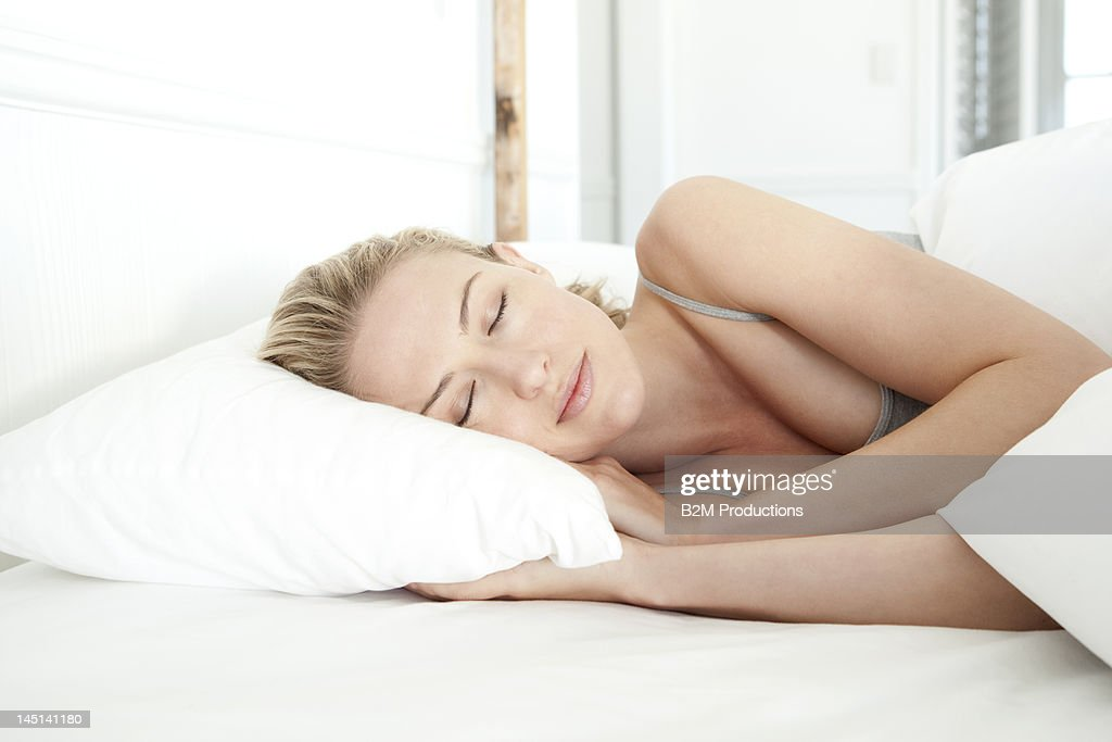 Woman sleeping in bed : Stock Photo