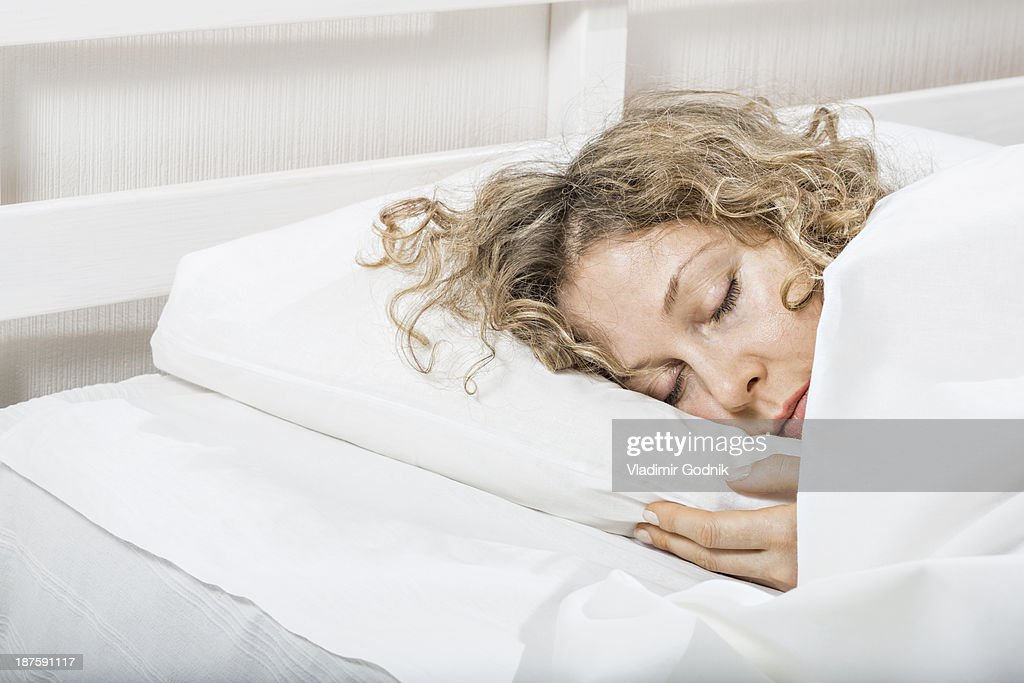 Woman Sleeping N Bed Stock Photo Getty Images