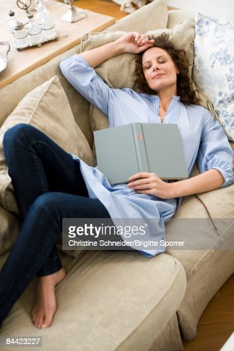 Woman sleeping on a couch : Stock Photo