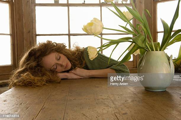 Woman sleeping on kitchen table