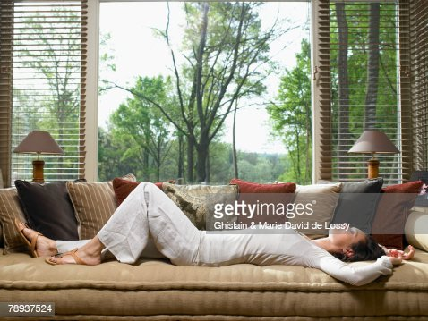 Woman Sleeping On Sofa In Living Room Photo – Sleeping in the Living Room