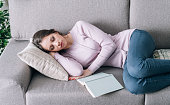 Young attractive woman sleeping on the couch at home, she was reading a book