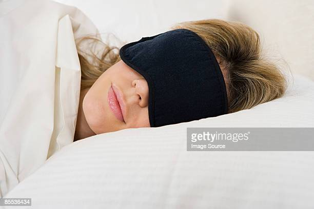 Woman sleeping with eye mask on