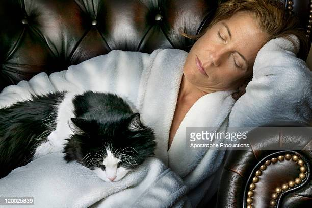 Woman sleeping with pet cat
