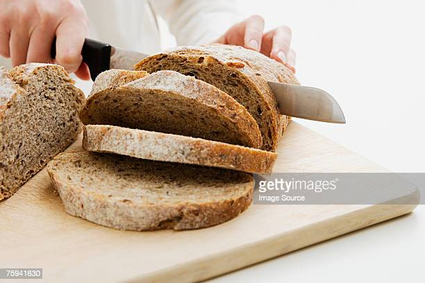 Woman slicing loaf