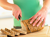 Woman Slicing Mixed Grain Bread