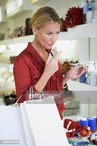 Woman smelling perfume : Stock Photo
