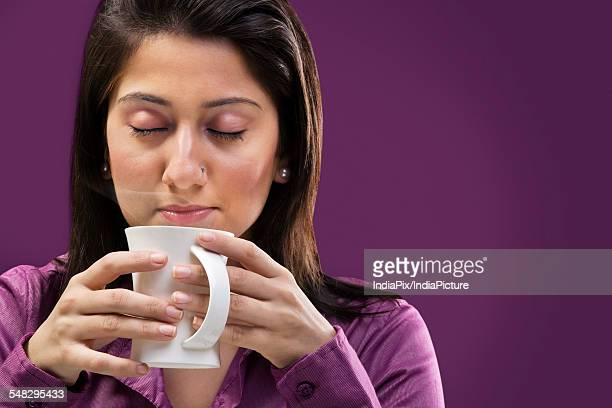 Woman smelling the coffee